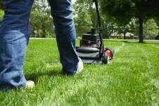 A man mows the lawn.