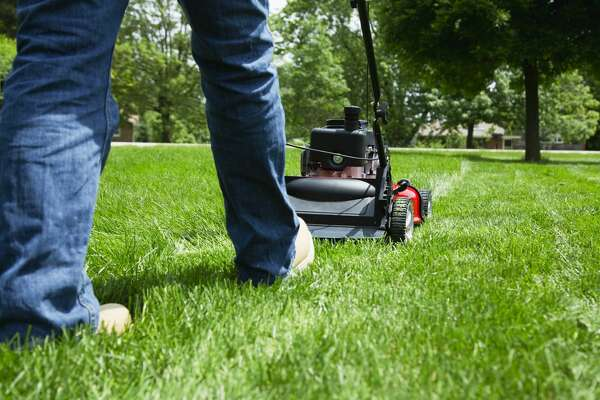 A man mows the lawn.