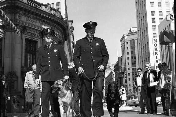 Sept. 24, 1962: Officers Robert McDonnell and Mario Touani with Sultan and Neemo, two of the first dogs in the San Francisco Police Department K-9 corps.