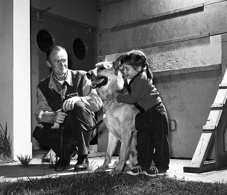 """Officer Robert McDonnell and his daughter Maureen with """"King,"""" the German shepherd that replaced Sultan in the San Francisco Police Department K-9 corps. Photo: Art Frisch, The Chronicle"""
