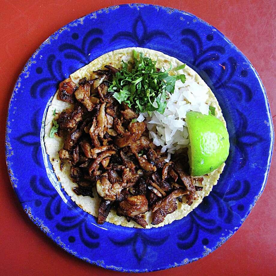 Al pastor taco on a handmade corn tortilla from Taquería Tequila Jalisco. Photo: Mike Sutter /San Antonio Express-News