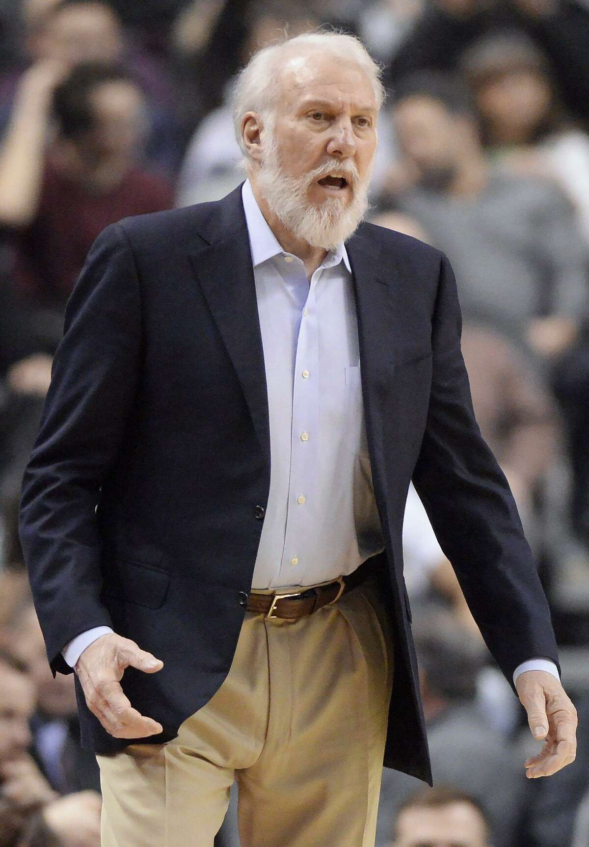 Spurs coach Gregg Popovich watches his team during first half against the Raptors on Jan. 24, 2017, in Toronto.
