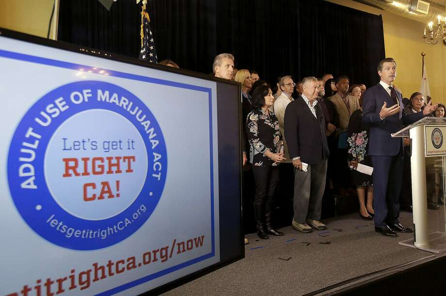 Lt. Gov. Gavin Newsom (right) was among the proponents of Prop. 64, which OKd recreational marijuana use in California. Photo: Jeff Chiu, Associated Press
