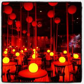 Designer Stanlee Gatti adorned the interior of Bimbo's 365 Club with large red balloons and lighted table-tops at the Take Back the Ball fundraiser. Jan 2017.