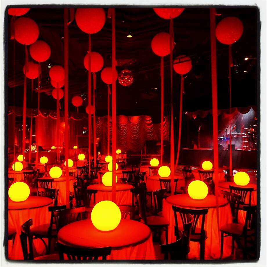 Designer Stanlee Gatti adorned the interior of Bimbo's 365 Club with large red balloons and lighted table-tops at the Take Back the Ball fundraiser Jan. 21. Photo: Catherine Bigelow, Special To The Chronicle