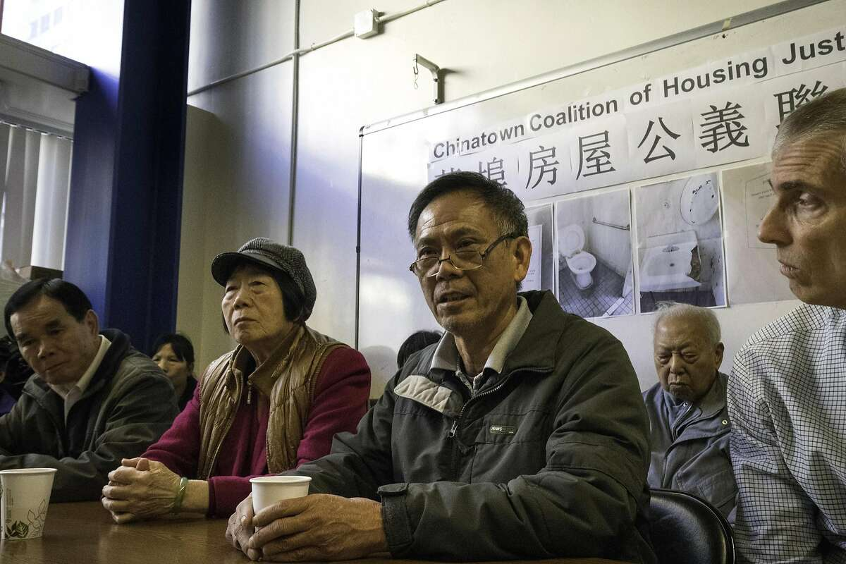Guy Yi Deng sharing about his experience in living at SRO at 937 Clay Street on Thursday, Jan. 26, 2017 in San Francisco, Calif. From left: Wing Ho Leung, Feng Xiao Chen, Guy Yi Deng, Qing Zhi Deng and attorney Steve Collier Chinatown Community Development Center is alleging that the owner of a Chinatown CDC (SRO) is harassing long-time residents -- hoping to get them to leave in order to replace them with high rent paying tech workers and students.