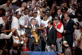 06/22/1994 - NBA Commissioner David Stern presents the NBA Championship Trophy to the Houston Rockets team after they defeated the New York Knicks in the 7th and final game, June 22, 1994. Â Houston Chronicle