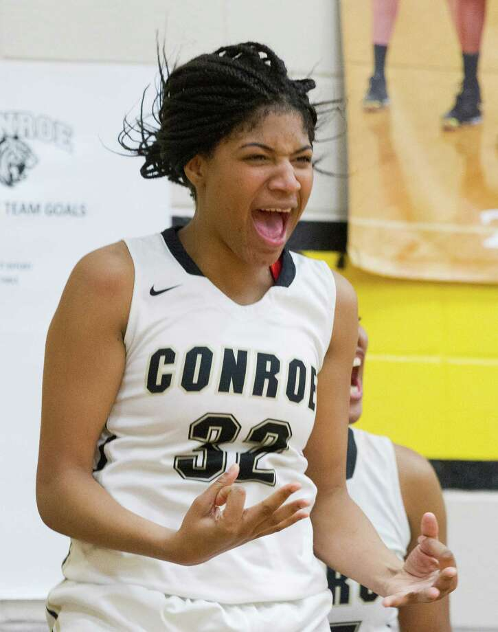 Conroe center Maya Grant (32) celebrates a three-pointer during the third quarter of a District 16-6A high school girls basketball game at Conroe High School, Jan. 24, 2017, in Conroe. Conroe defeated Montgomery 80-28. Photo: Jason Fochtman, Staff Photographer / Houston Chronicle
