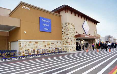 Community members gather in the parking lot of Sam's Club in Valley Ranch Town Center for the grand opening celebration Thursday, Jan. 26 in New Caney.