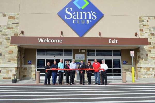 The East Montgomery County Improvement District help perform a ribbon cutting ceremony before the Sam's Club soft opening even in Valley Ranch Town Center Wednesday, Jan. 25. From left to right:  EMCID directors Stephen Carlisle, Leonard Rogers, Fred Wetz, Katherine Persson and Martin Zepeda; Sam's Club manager Taylor Jones, EMCID chairman of the board Brenda Webb, director Scott Hesson and EMCID president and CEO Frank McCrady.