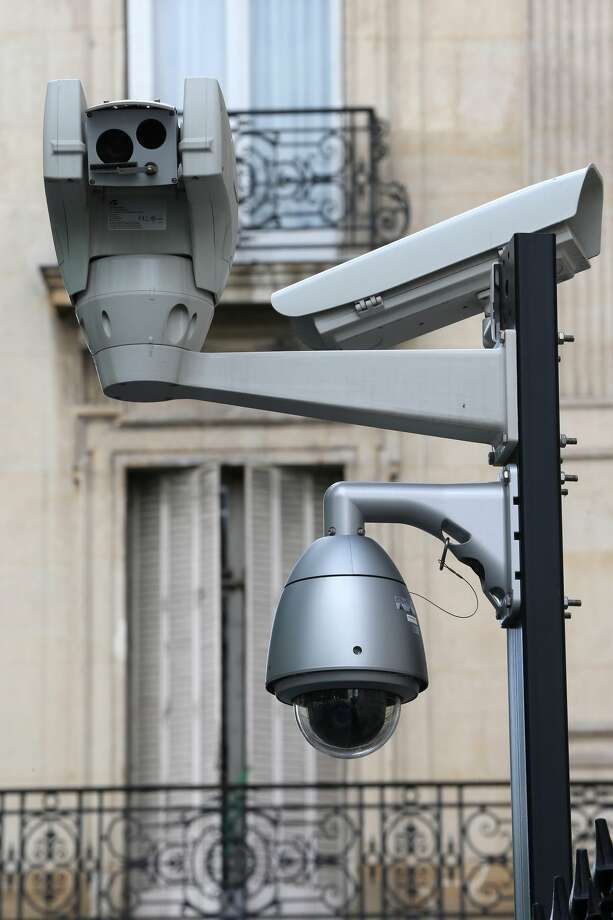 "Seattle City Council member Kshama Sawant is taking aim at surveillance cameras like these installed by federal agencies atop city utility poles and collecting footage of public areas. Sawant says the ""warrantless"" surveillance of Seattle should not be allowed unless there is a warrant or City Council approval. Photo: BSIP/UIG Via Getty Images"