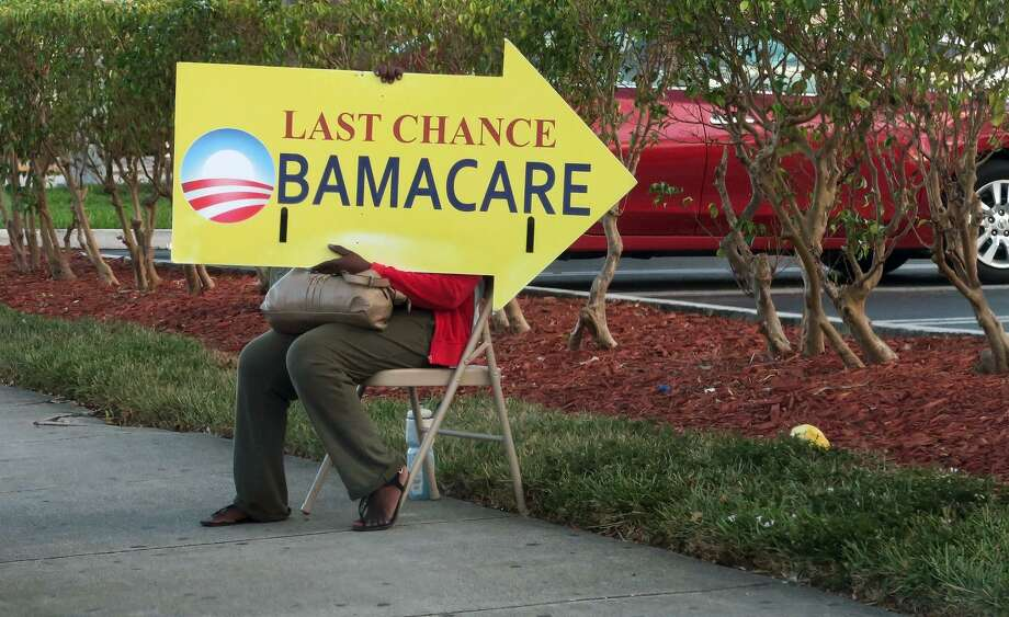 (This file photo taken on Nov. 27, 2016, shows a woman holding an Obamacare sign in front of a medical center in Miami. The Republican-led U.S. Senate held a procedural vote on Jan. 12, 2017, which set in motion the eventual rollback of The Affordable Care Act, President Barack Obama's signature healthcare bill. President Donald Trump is also moving toward repeal. Photo: Rhona Wise /AFP /Getty Images / AFP or licensors