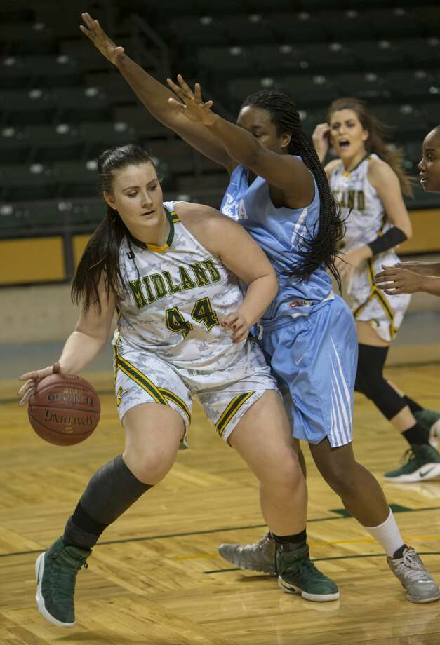 Midland College's Lisa Kaempf brings the ball in the lane as Odessa College's Leticia Soares defends Thursday 01-26-17 at the Chaparral Center. Tim Fischer/Reporter-Telegram Photo: Tim Fischer/Midland Reporter-Telegram