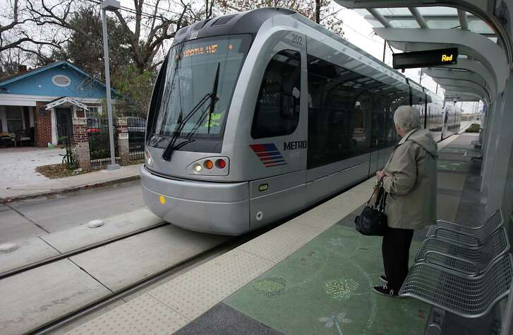 A woman waits for a train at Metro's Rail Red Line Moody Park Station in Houston.  (Chronicle File Photo)