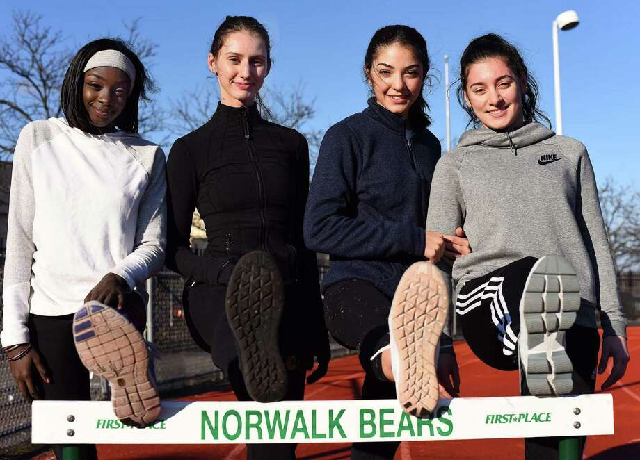 Norwalk hurdlers, from left, Penda M'Bengue, Frideriki Koletsos, Lily Hadin and Edona Jakaj are four of nine Bears who have qualified for the state meet in the event this winter season. Norwalk has a long and storied history of putting out top-notch hurdlers. Photo: John Nash / Hearst Connecticut Media / Norwalk Hour