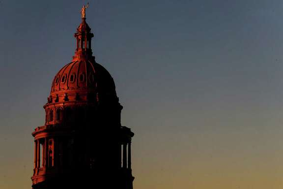 The sun sets over the Texas Capitol in Austin.  (Jon Shapley / Houston Chronicle )