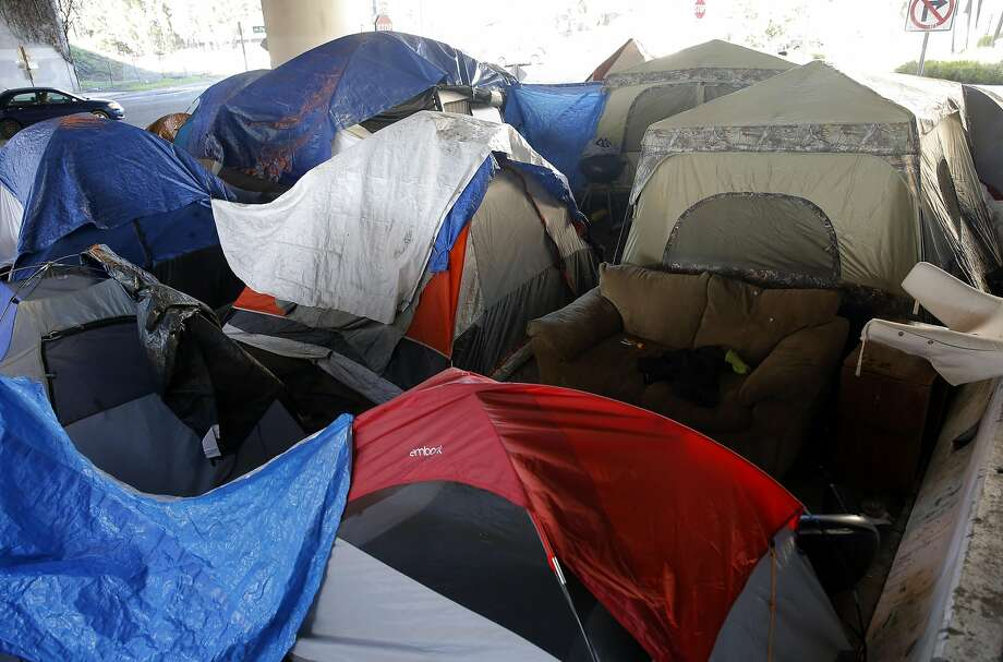 "Oakland's first sanctioned encampment, the ""Compassionate Community"" experiment, is crammed tight under Interstate 580 at 35th and Magnolia streets in Oakland. Photo: Michael Macor, The Chronicle"