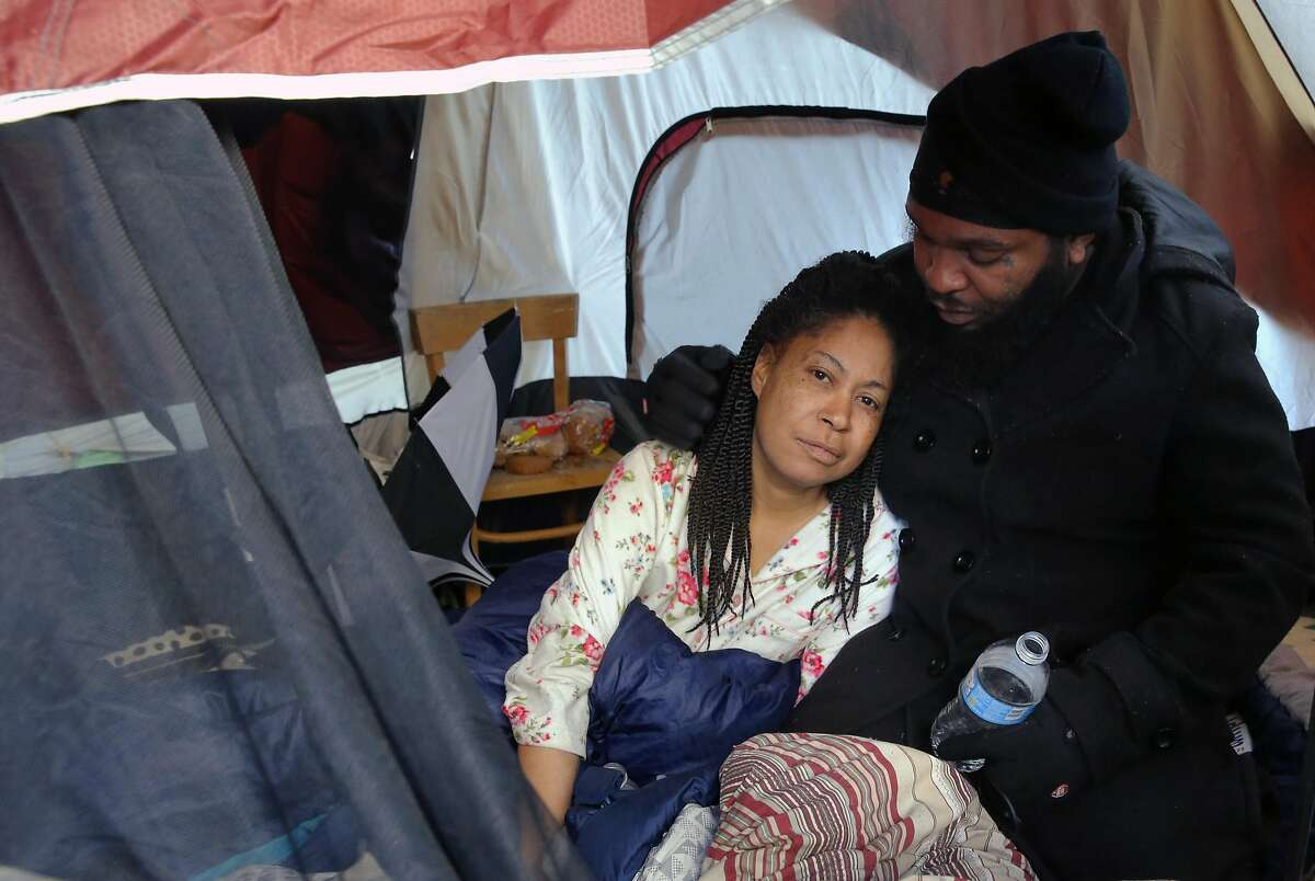 """Felicia Paul and her husband Dejon King at Oakland's first sanction encampment, the """"Compassionate Community"""" experiment, where they have been for the past three months under the 580 freeway at 35th and Magnolia streets in Oakland, Ca., on Thursday Jan. 26, 2017."""