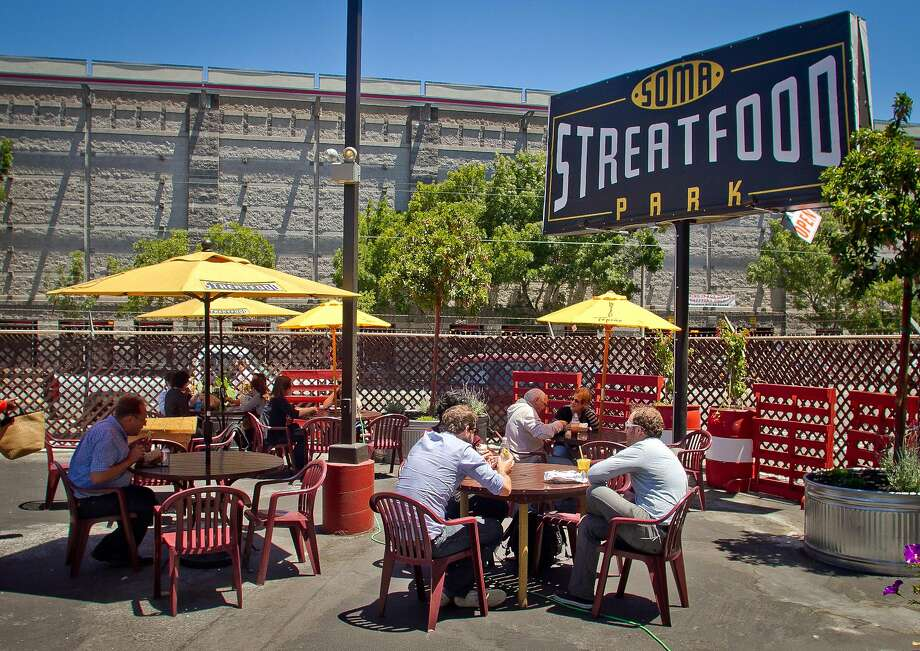 People eat their food during lunch time at the Streat Food Park in San Francisco, Calif., is seen on Thursday, June 28th, 2012. Photo: John Storey, Special To The Chronicle
