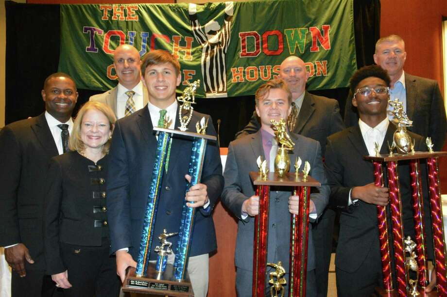 Sportsmanship winners, from the Touchdown Club of Houston Sportsmanship Luncheon on Jan. 25 (from left): Eric Anderson, FCA regional head, title sponsor; Pam Lovett, senior vice president, Comerica Bank, title sponsor; Mark Krimm, head football coach, Westbury Christian, first place Class 4A-Private High School classification; Will Symonds, Westbury Christian senior football player (with blue trophy); Josh Matthews, Willis senior football player (purple shirt with red trophy); Audie Jackson, head football coach, Willis, first place Class 5A classification; D.J. Johnson, Clear Creek High School football player (yellow shirt with red trophy); And Darrell Warden, head football coach at Clear Creek High School, first place Class 6A classification. Photo: Westbury Christian School
