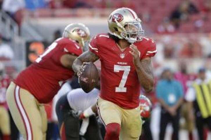 San Francisco 49ers quarterback Colin Kaepernick (7)  over. (AP Photo/Marcio Jose Sanchez)