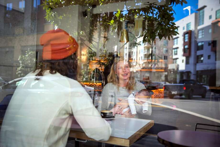 Heini Vesander (center) is seen through a window as she chats with Nasim Selmani at Réveille Coffee on Longbranch Road and Fourth Street. Photo: Gabrielle Lurie, The Chronicle