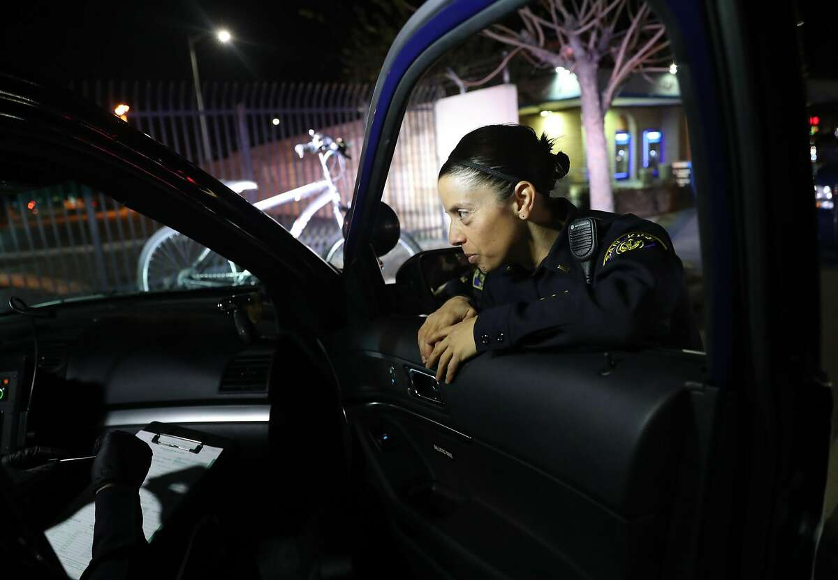 San Jose Police Department Lt. Elle Washburn confers with fellow officers in San Jose, Calif., on Tuesday, January 24, 2017. Due to police short staffing, Lt. Washburn has returned to patrols for the first time in 4 years.