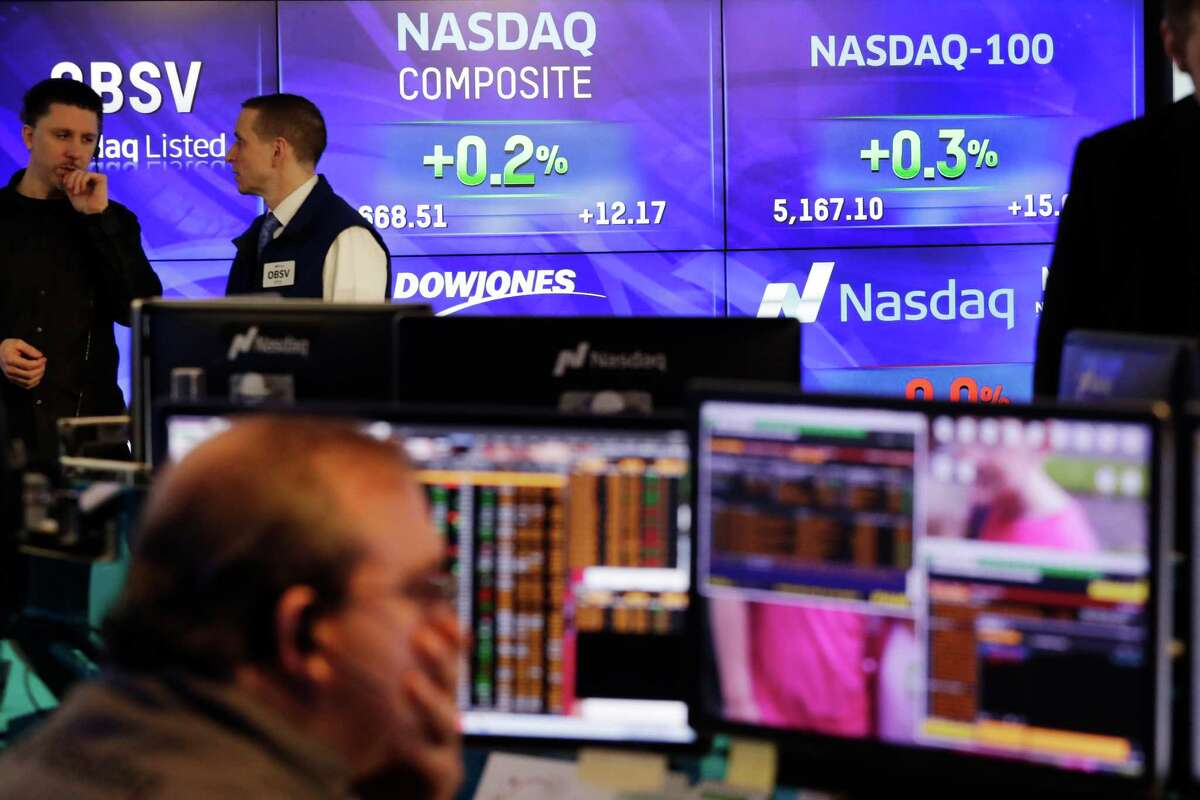 Screens for the Nasdaq Composite and Nasdaq-100 are displayed at Nasdaq, Thursday, Jan. 26, 2017, in New York. It's been a record-making week on Wall Street. The S&P 500 index and Nasdaq composite closed at all-time highs on Tuesday and Wednesday. (AP Photo/Mark Lennihan)