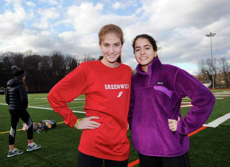 Greenwich girls track team members, Lia Zavattaro, left, a pole vaulter, and Emily Philippides, a middle distance runner, during practice at the Cardinal Stadium track at Greenwich High School on Thursday. Photo: Bob Luckey Jr. / Hearst Connecticut Media / Greenwich Time