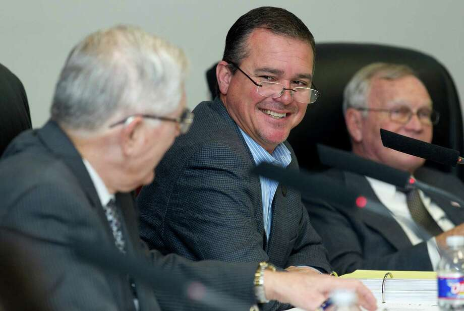 Conroe City Councilman Duane Ham laughs along with Mayor Toby Powell during a city council meeting Wednesday, Jan. 26, 2017, in Conroe. The council approved a budget up to $50,000 to send Ham to Austin to lobby for the city regarding water related legislation. Photo: Jason Fochtman, Staff Photographer / Houston Chronicle