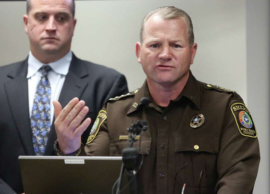 Fort Bend County Sheriff Troy Nehls, right, speaks at a Thursday news conference regarding multi-agency work in the arrest of 17 burglars believed responsible for 120 Houston-area home invasions. Photo: Yi-Chin Lee, Staff / © 2017  Houston Chronicle