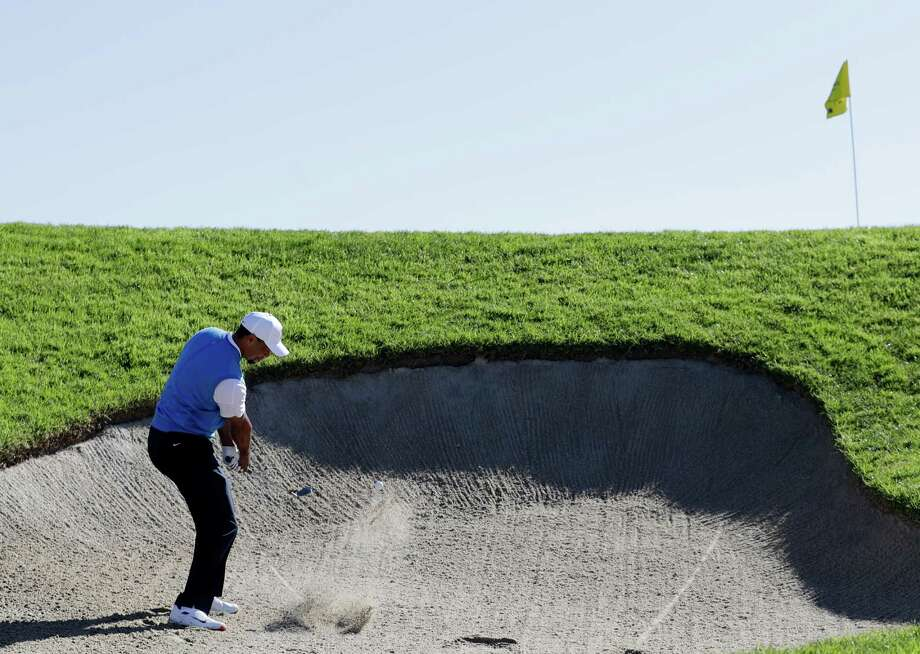 'I fought my tail off' says Woods after PGA return