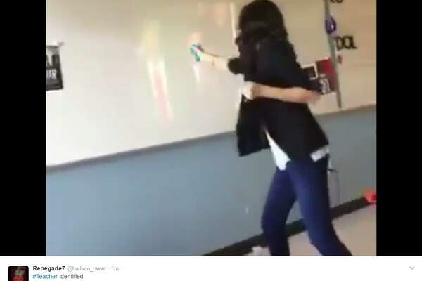 "Payal Modi, an art teacher at H. W. Adamson High School in Dallas, was plced on administrative leave on Thursday, Jan. 26, 2017. Modi is seen in a video online shooting at an image of President Donald Trump in a classroom with a squirt gun yelling, Die!""   Image source:  Twitter"