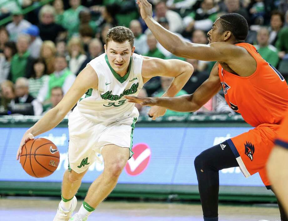 Marshall's Jon Elmore (33) drives against UTSA's Bola Alade (14) during an NCAA college basketball game Thursday, Jan. 26, 2017, at the Cam Henderson Center in Huntington, W.Va. (Sholetn Singer/The Herald-Dispatch via AP) Photo: Sholten Singer, Associated Press / The Herald-Dispatch