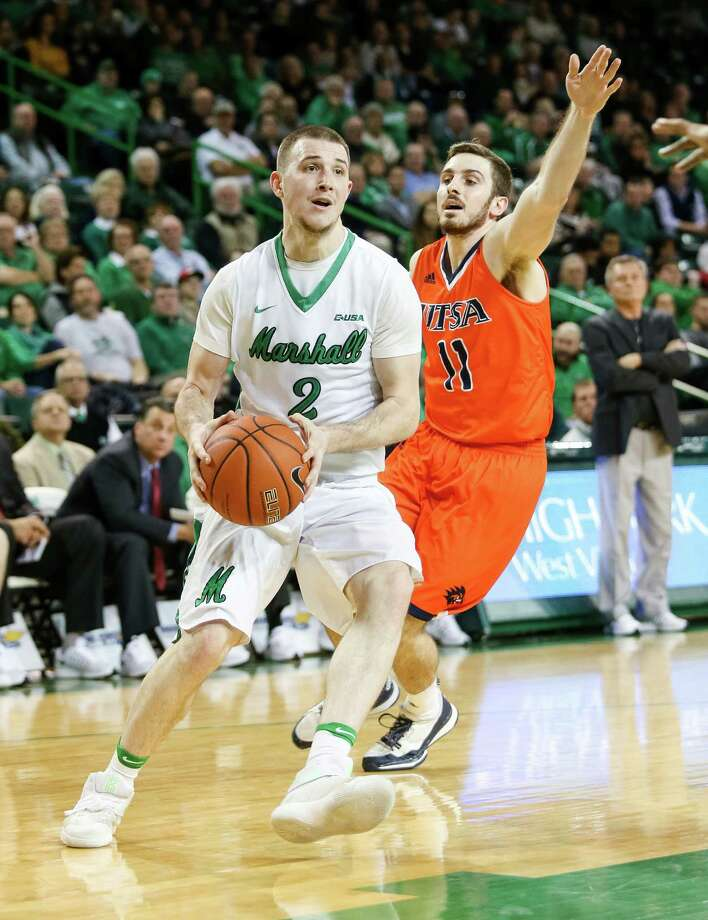 Marshall's Stevie Browning (2) drives to the basket against UTSA's Austin Karrer (11) during an NCAA college basketball game Thursday, Jan. 26, 2017, in Huntington, W.Va. (Sholten Singer/The Herald-Dispatch via AP) Photo: Sholten Singer, Associated Press / The Herald-Dispatch