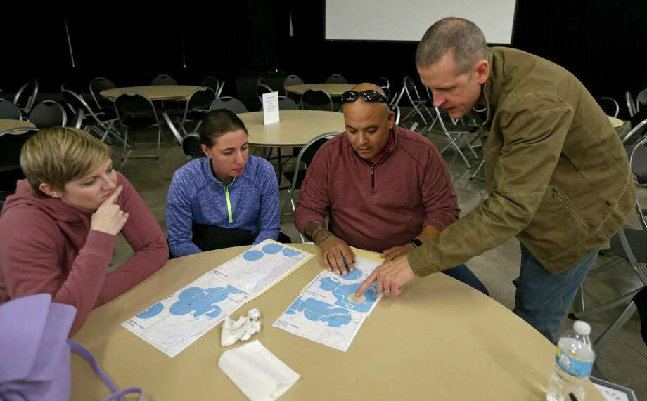 Emily Miller (from left), Marissa Mueller, Rex Brien, all of SAMMinistries, and Justin Schmitt, of USAA, look at a map  during the South Alamo Regional Alliance for the Homeless annual point-in-time count held Thursday Jan. 26, 2017. Photo: Edward A. Ornelas, Staff / San Antonio Express-News / © 2017 San Antonio Express-News