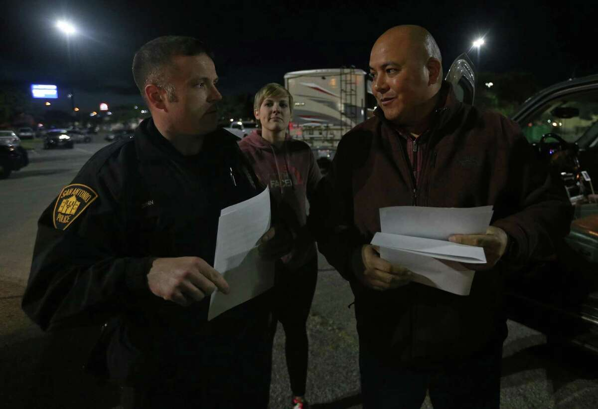 San Antonio Police Department Officer Dennis Quinn talks with Rex Brien, of SAMMinistries, as Emily Miller, of SAMMinistries, (rear center) listens while searing for homeless in the Wal-mart parking lot at the intersection of US 281 and Loop 1604 during the South Alamo Regional Alliance for the Homeless annual point-in-time count held Thursday Jan. 26, 2017.