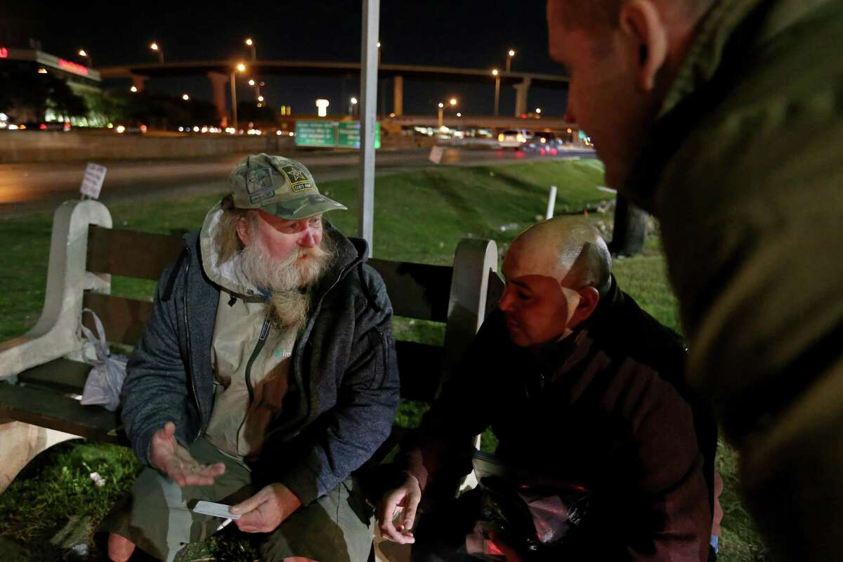 """Darrell """"Woody"""" Parke, 59, who has been homeless on and off for years, (from left) talks with Rex Brien, of SAMMinistries, and Justin Schmitt, of USAA, during the South Alamo Regional Alliance for the Homeless annual point-in-time count held Thursday Jan. 26, 2017. Parke, who is a Vietnam War veteran, is in danger of being evicted from his apartment. He was waiting for a bus after returning from a Veterans Administration site to get prescription medications."""