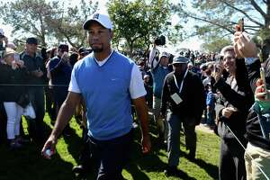 In his first PGA Tour action since Aug. 23, 2015, Tiger Woods completed the first round with a disappointing 4-over 76 score in the Farmers Insurance Open, 11 shots behind leader Justin Rose.