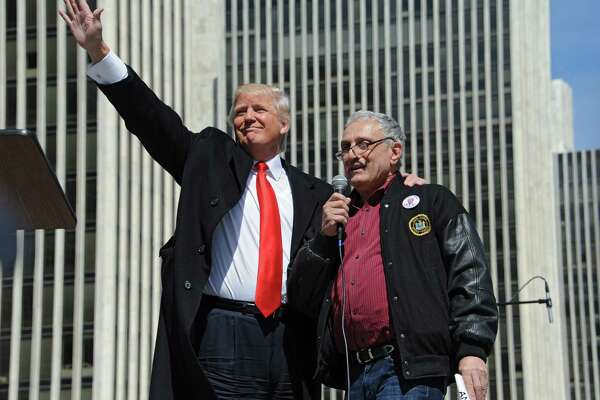 Donald Trump, left, stands with Carl Pasquale Paladino,  businessman and political activist from Buffalo, after he spoke to a crowd of Second Amendment advocates rallying against the NY SAFE Act at the Empire State Plaza Tuesday April 1, 2014 in Albany, N.Y. (Lori Van Buren / Times Union) ORG XMIT: MER2014040115350439
