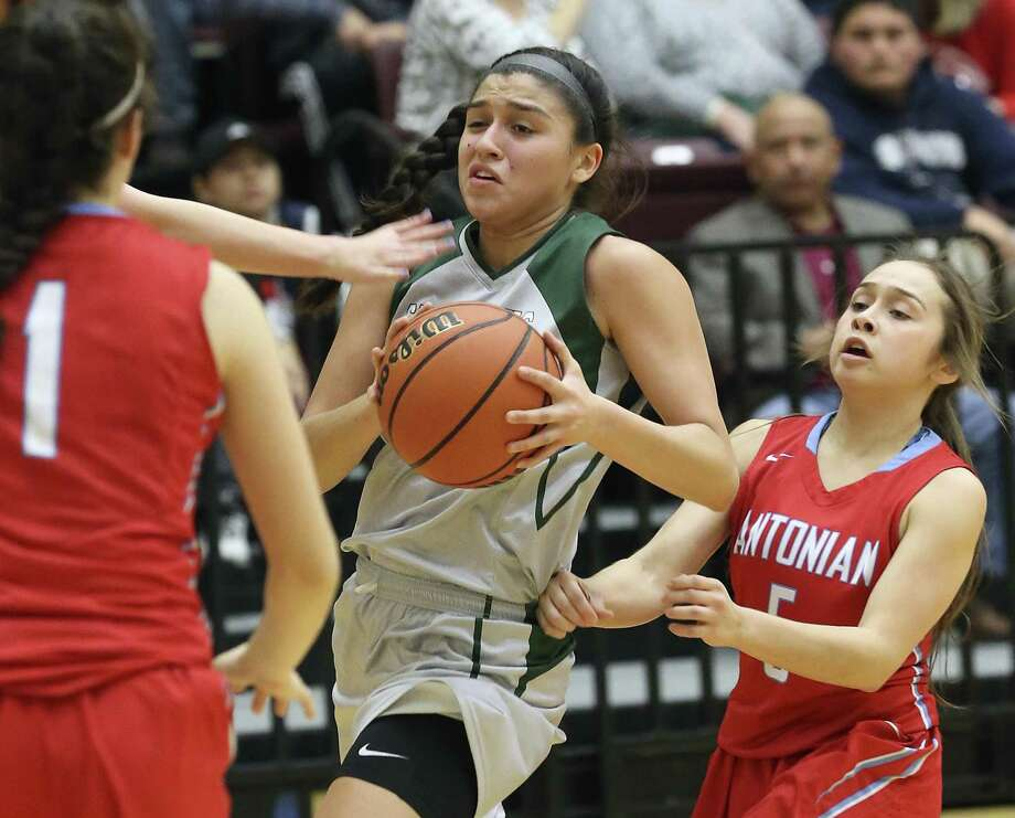 Incarnate Word's Sophia Ramos works her way past Avery Alva (right) and the Antonian defense during the Shamrocks' blowout victory at Littleton Gym. Photo: Tom Reel / San Antonio Express-News / 2017 SAN ANTONIO EXPRESS-NEWS