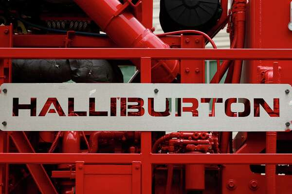 Halliburton, which displays its logo on a pressure pump outside a Houston facility, has extended its deadline for gaining regulatory approval to buy competitor Baker Hughes. (Bloomberg photo)