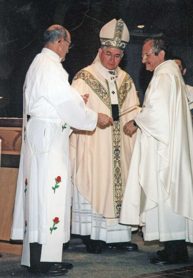 Monsignor Michael Boulette, at right, with then-Archbishop José H. Gomez at the monsignor investiture Mass in 2005. Photo: Archdiocese Of San Antonio /Courtesy