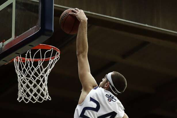 Saint Mary's Calvin Hermanson (24) scores over San Francisco's Chase Foster during the first half of an NCAA college basketball game Thursday, Jan. 26, 2017, in Moraga, Calif. (AP Photo/Ben Margot)