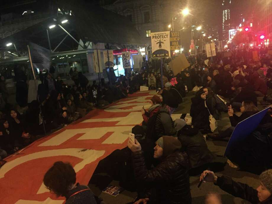 Hundreds of protestors briefly filled Mission Street across from the Federal Building Thursday night to decry President Trump's executive actions on energy production. Photo: Michael Bodley / Michael Bodley / The Chronicle