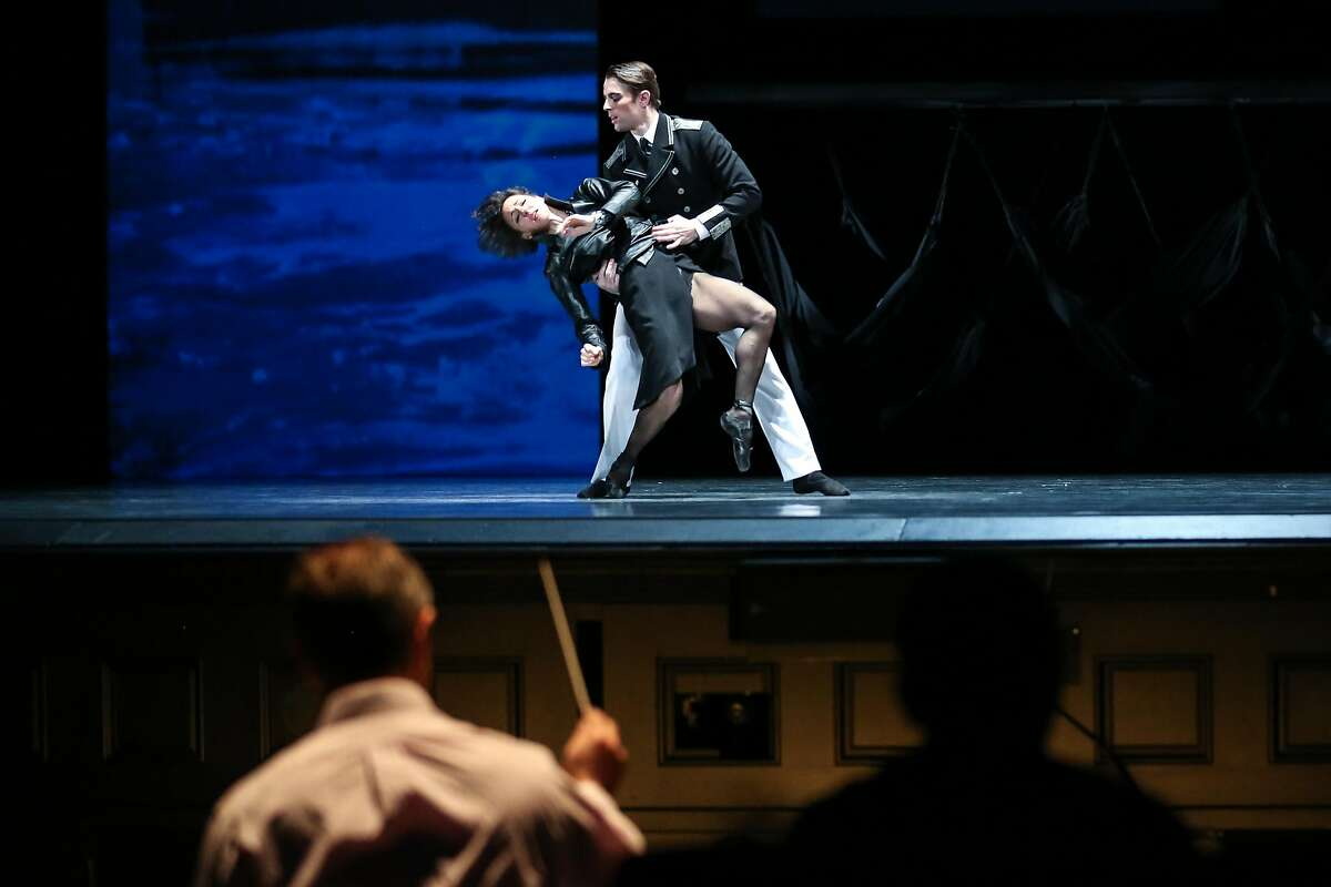SF Ballet's Lorena Feij�o, Luke Ingham, and conductor Martin West perform in a dress rehearsal of Optimistic Tragedy on Thursday, January 26, 2017 in San Francisco, Calif.