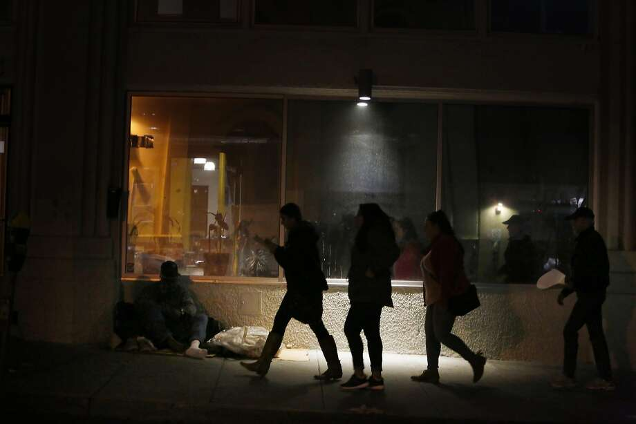 Neha Chitlangia (second from left to right), Karina Rodriguez, Elisa Sanchez and Don Stannard -Friel walk past a homeless man (left)  as they volunteer during the Homeless Point-in-Time Count on Thursday, January 26,  2017 in San Francisco, Calif.  Chitlangia, Rodriguez and Sanchez are students of Don Stannard-Friel's Promise of the Inner City class at Notre Dame de Namur University. Photo: Lea Suzuki, The Chronicle