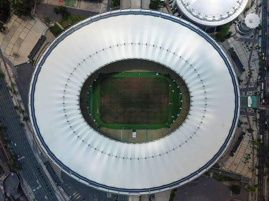 View of the world-famous Maracana Stadium in Rio de Janeiro on January 18, 2017.  After playing a key role in the 2014 World Cup and 2016 Olympic Games, hosted by Brazil, the iconic Maracana Stadium has fallen into a state of abandon due to a contract dispute, and is closed to tourists. / AFP / VANDERLEI ALMEIDA        (Photo credit should read VANDERLEI ALMEIDA/AFP/Getty Images) Photo: VANDERLEI ALMEIDA/AFP/Getty Images