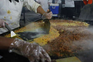 Saint Philip's College culinary students cook for the 39th Annual Cowboy Breakfast Friday January 27, 2017 at Cowboys Dance Hall. The event served 12,000 chorizo and egg tacos and 5,000 potato and egg tacos.
