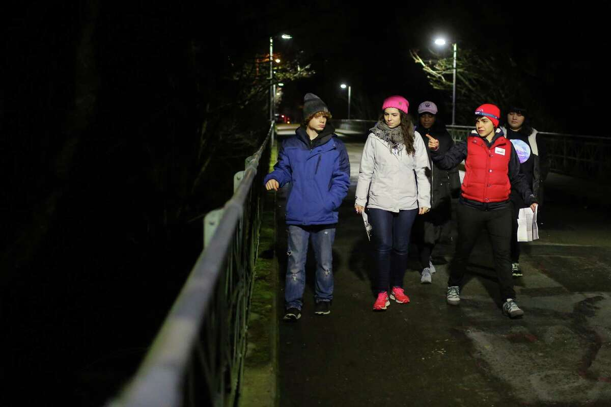 From left, Tim Rennaker, Hannah Hunthausen, Jennifer Williams, Emily Mirra, and Gina Ohms search Ravenna for signs of people sleeping outside as they take part in the annual Point in Time count, early Friday morning, Jan. 27, 2017. Around 1,000 volunteers and guides spread out across the city Friday to count the number of people living without shelter.